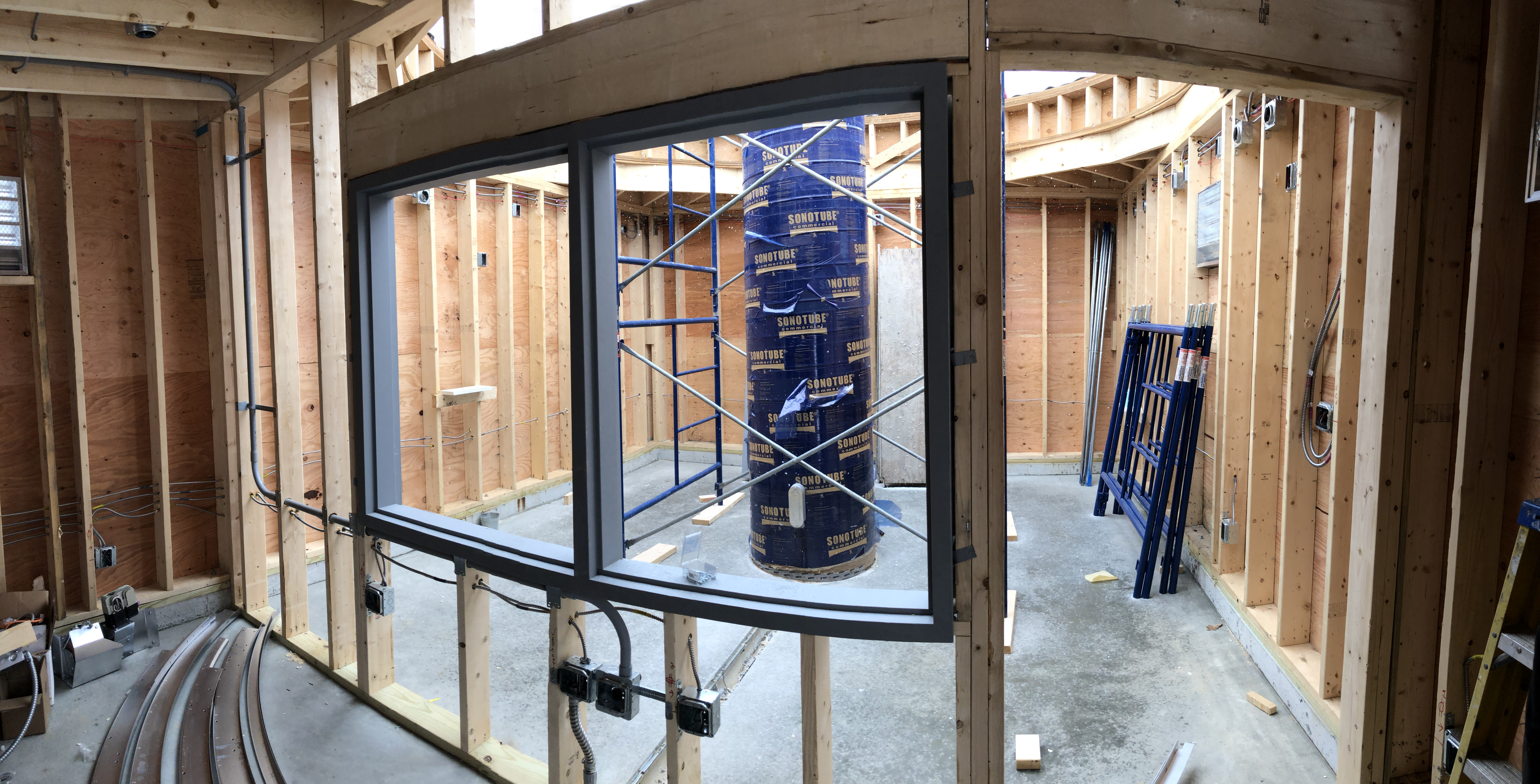 The view of the telescope room through the framed wall of the control room. The window casement has been installed along with initial conduit for electrical. network and telescope control lines.